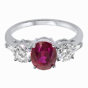 Oval Dark Pink Sapphire & Brilliant Cut Diamond Three Stone Ring_ flat down